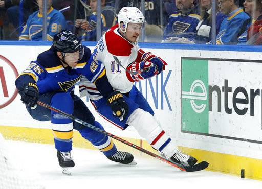 Montreal Canadiens' Brendan Gallagher (11) and St. Louis Blues' Paul Stastny (26) chase the puck along the boards during the first period of an NHL hockey game Tuesday, Jan. 30, 2018, in St. Louis.