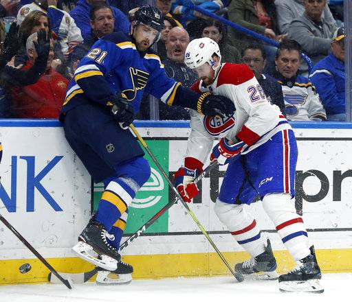 St. Louis Blues' Patrik Berglund, of Sweden, and Montreal Canadiens' Jeff Petry (26) try to find the puck during the second period of an NHL hockey game Tuesday, Jan. 30, 2018, in St. Louis.