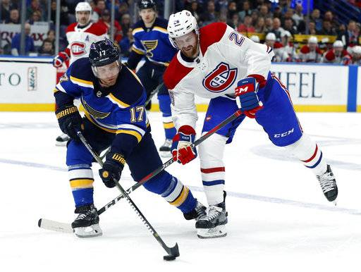 St. Louis Blues' Jaden Schwartz (17) and Montreal Canadiens' Jeff Petry (26) chase the puck during the second period of an NHL hockey game Tuesday, Jan. 30, 2018, in St. Louis.
