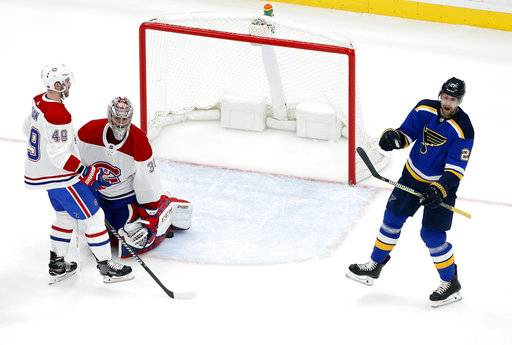 St. Louis Blues' Patrik Berglund, right, of Sweden, celebrates after scoring past Montreal Canadiens' Carey Price (31) and Logan Shaw (49) during the third period of an NHL hockey game Tuesday, Jan. 30, 2018, in St. Louis. The Blues won 3-1.