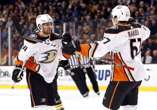 Anaheim Ducks' Adam Henrique (14) celebrates his goal against the Boston Bruins with teammate Rickard Rakell during the first period of an NHL hockey game Tuesday, Jan. 30, 2018, in Boston.