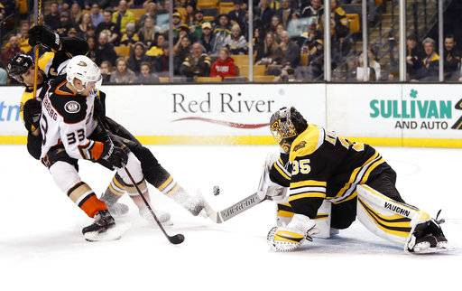Anaheim Ducks' Jakob Silfverberg (33) knocks the puck past Boston Bruins goaltender Anton Khudobin for a goal during the first period of an NHL hockey game in Boston on Tuesday, Jan. 30, 2018.