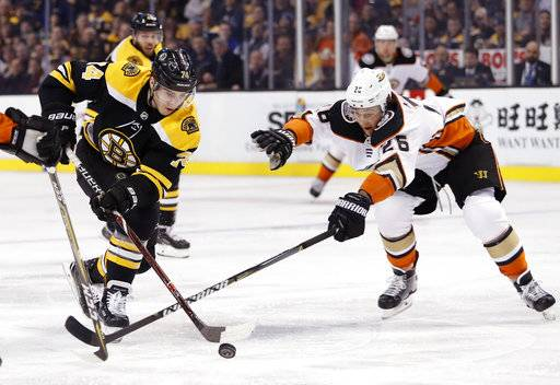 Boston Bruins' Jake DeBrusk tries to get past Anaheim Ducks' Brandon Montour during the second period of an NHL hockey game Tuesday, Jan. 30, 2018, in Boston.