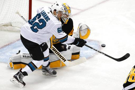 San Jose Sharks' Kevin Labanc (62) can't get his stick on the puck in front of Pittsburgh Penguins goaltender Matt Murray during the first period of an NHL hockey game in Pittsburgh, Tuesday, Jan. 30, 2018.