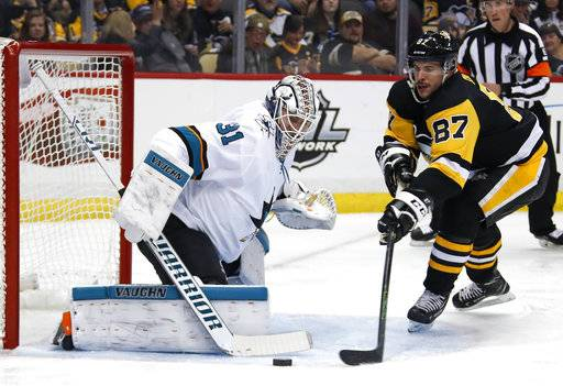 Pittsburgh Penguins' Sidney Crosby (87) can't get to a rebound in front of San Jose Sharks goaltender Martin Jones during the second period of an NHL hockey game in Pittsburgh, Tuesday, Jan. 30, 2018.