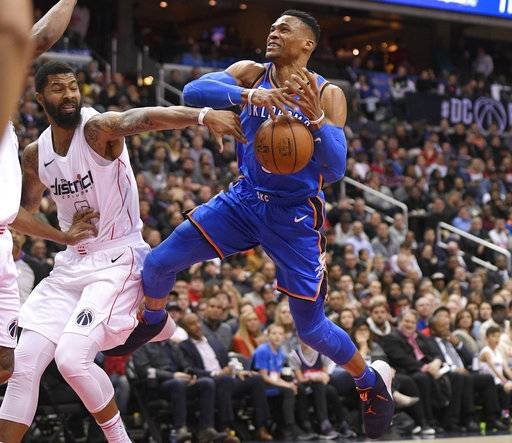 Oklahoma City Thunder guard Russell Westbrook (0) loses the ball as Washington Wizards forward Markieff Morris (5) defends during the first half of an NBA basketball game Tuesday, Jan. 30, 2018, in Washington.