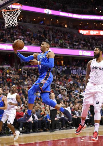Oklahoma City Thunder guard Russell Westbrook (0) goes to the basket past Washington Wizards forward Markieff Morris (5) during the first half of an NBA basketball game Tuesday, Jan. 30, 2018, in Washington.