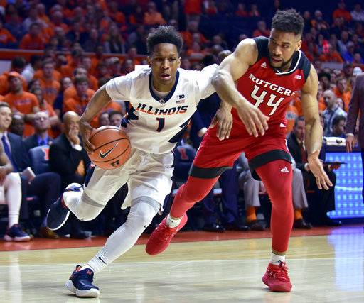 Illinois guard Trent Frazier (1) drives to the basket against Rutgers guard Souf Mensah (44) during the second half of an NCAA college basketball game in Champaign, Ill., Tuesday, Jan. 30, 2018. Illinois won 91-60.