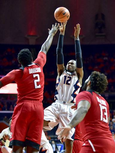 Illinois forward Leron Black (12) shoots against Rutgers center Shaquille Doorson (2) and forward Matt Bullock (13) during the second half of an NCAA college basketball game in Champaign, Ill., Tuesday, Jan. 30, 2018. Illinois won 91-60.
