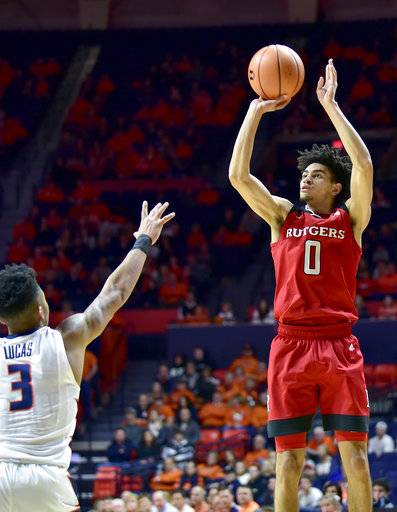 Rutgers guard Geo Baker (0) shoots over Illinois guard Te'Jon Lucas (3) during the first half of an NCAA college basketball game in Champaign, Ill., Tuesday, Jan. 30, 2018.