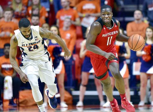 Rutgers forward Eugene Omoruyi (11) brings the ball up as Illinois guard Mark Alstork (24) follows during the first half of an NCAA college basketball game in Champaign, Ill., Tuesday, Jan. 30, 2018.
