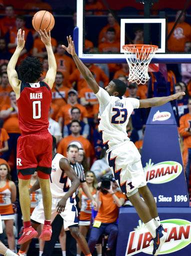 Illinois guard Aaron Jordan (23) defends against a shot from Rutgers guard Geo Baker (0) during the second half of an NCAA college basketball game in Champaign, Ill., Tuesday, Jan. 30, 2018. Illinois won 91-60.