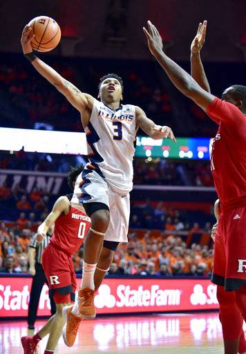 Illinois guard Te'Jon Lucas (3) shoots against Rutgers forward Mamadou Doucoure, right, during the second half of an NCAA college basketball game in Champaign, Ill., Tuesday, Jan. 30, 2018. Illinois won 91-60.
