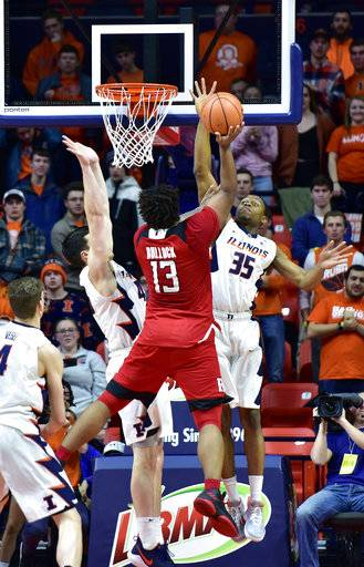 Illinois guard Samson Oladimeji (35) and forward Cameron Liss (45) defend against a shot from Rutgers forward Matt Bullock (13) during the second half of an NCAA college basketball game in Champaign, Ill., Tuesday, Jan. 30, 2018. Illinois 91-60.