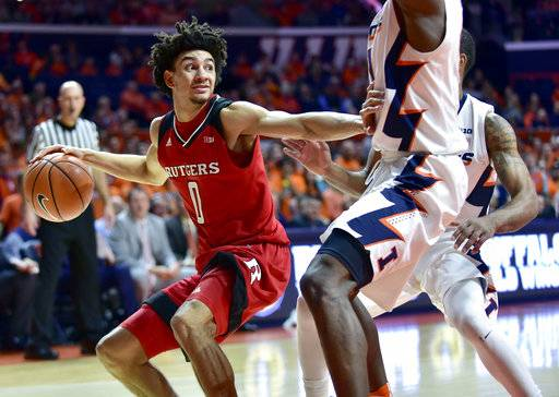 Rutgers guard Geo Baker (0) looks for room to pass under pressure from Illinois forward Greg Eboigbodin, front, and guard Mark Alstork during the first half of an NCAA college basketball game in Champaign, Ill., Tuesday, Jan. 30, 2018.