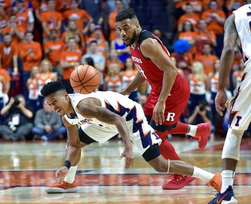 Illinois guard Te'Jon Lucas (3) and Rutgers guard Souf Mensah (44) watch the ball during the first half of an NCAA college basketball game in Champaign, Ill., Tuesday, Jan. 30, 2018.