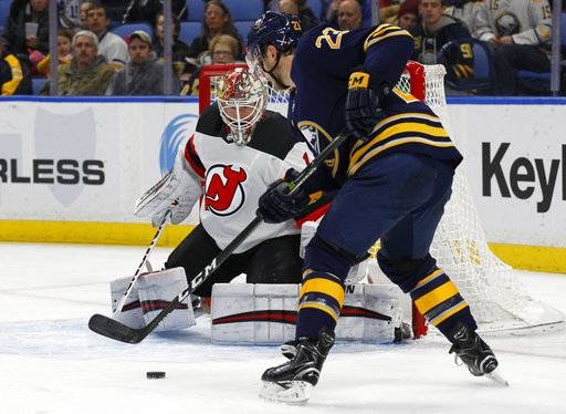 Buffalo Sabres forward Sam Reinhart (23) is stopped by New Jersey Devils goalie Keith Kinkaid (1) during the first period of an NHL hockey game, Tuesday, Jan. 30, 2018, in Buffalo, N.Y.