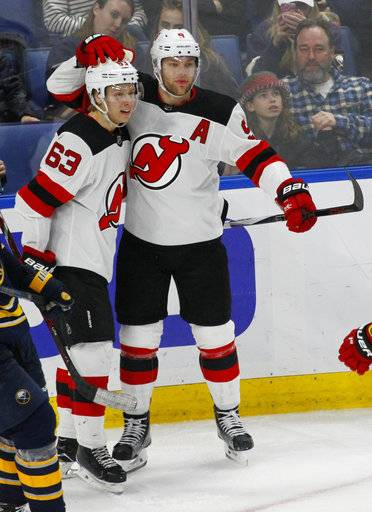 New Jersey Devil forwards Jesper Bratt (63) and Taylor Hall (9) celebrate a goal during the third period of an NHL hockey game against the Buffalo Sabres, Tuesday, Jan. 30, 2018, in Buffalo, N.Y.
