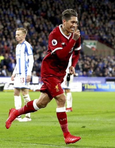 Liverpool's Roberto Firmino celebrates scoring his side's second goal of the game against Huddersfield Town during their English Premier League soccer match at the John Smith's Stadium in Huddersfield, England, Tuesday Jan. 30, 2018. (Martin Rickett/PA via AP)