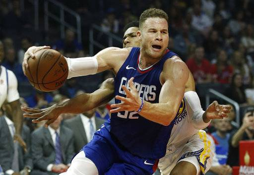 FILE- In this Jan. 6, 2018, file photo, Los Angeles Clippers forward Blake Griffin, right, drives to the basket against Golden State Warriors guard Patrick McCaw during the first half of an NBA basketball game in Los Angeles. The Detroit Pistons dramatically shook their struggling roster by acquiring one of the NBA's top players in Griffin in a trade with the Clippers. The deal for the five-time All-Star forward was announced early Tuesday, Jan. 30, 2018, giving Detroit a player who has been the face of the Clippers but whose career has been undercut by injuries.