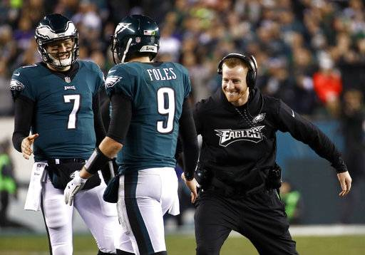 FILE - In this Sunday, Jan. 21, 2018, file photo, Philadelphia Eagles' Carson Wentz, right,  congratulates Nick Foles (9) during the second half of the NFL football NFC championship game against the Minnesota Vikings in Philadelphia. Wentz, who is injured, watched both playoff games from the sideline, rooting hard for his teammates and enjoying their success without him. He'll be their No. 1 fan Sunday when they take on the New England Patriots and try to win the franchise's first NFL title since 1960.
