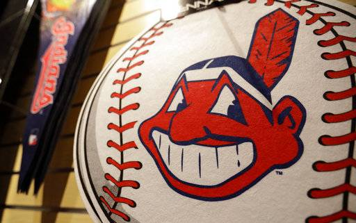A Chief Wahoo logo is shown on a baseball at the Cleveland Indians team shop, Monday, Jan. 29, 2018, in Cleveland. Divisive and hotly debated, the Chief Wahoo logo is being removed from the Cleveland Indians' uniform next year. The polarizing mascot is coming off the team's jersey sleeves and caps starting in the 2019 season. The Club will still sell merchandise featuring the mascot in Northeast Ohio.