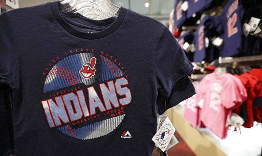 A kids shirt with the Chief Wahoo logo hangs at the Cleveland Indians team shop, Monday, Jan. 29, 2018, in Cleveland. Divisive and hotly debated, the Chief Wahoo logo is being removed from the Cleveland Indians' uniform next year. The polarizing mascot is coming off the team's jersey sleeves and caps starting in the 2019 season. The Club will still sell merchandise featuring the mascot in Northeast Ohio.