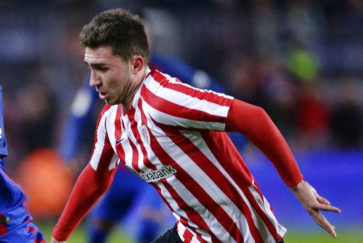 FILE - In this file photo dated Wednesday, Jan. 11, 2017, Athletic Bilbao's Aymeric Laporte in action during Copa del Rey, 16 round, against FC Barcelona at the Camp Nou in Barcelona, Spain. 23-year-old Athletic Bilbao says defender Frenchman Aymeric Laporte is reported Monday Jan. 29, 2018, to have paid his buyout clause, looks set to leave the club, opening the way for a transfer to Manchester City.