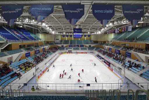 FILE - In this April 4, 2017, file photo, fans an under-17 World Championship Division II Group A hockey game game between Croatia and Estonia at Kwandong Hockey Center in Gangneung, South Korea. Olympic hockey played on wider international-sized ice changes everything about the style of play and is much different than the NHL. The United States and Canada in the past have needed to adjust to the bigger rinks, though most players going to South Korea are currently playing on it.