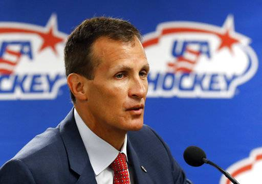 "FILE - In this Aug. 4, 2017, file photo, Tony Granato, United States olympic men's hockey coach, speaks during a news conference in Plymouth, Mich. Olympic hockey played on wider international-sized ice changes everything about the style of play and is much different than the NHL. The United States and Canada in the past have needed to adjust to the bigger rinks, though most players going to South Korea are currently playing on it. ""That is an advantage from a standpoint that they know the angles,� U.S. coach Tony Granato said."