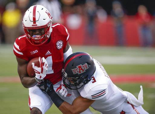 FILE - In this Sept. 2, 2017, file photo, Nebraska wide receiver Tyjon Lindsey (1) is tackled by Arkansas State defensive back B.J. Edmonds (3) during the first half of an NCAA college football game in Lincoln, Neb. Nebraska receiver Tyjon Lindsey and walk-on defensive lineman Dylan Owen were hospitalized after falling ill during winter conditioning drills, coach Scott Frost confirmed to two newspapers Tuesday, Jan. 30, 2018.