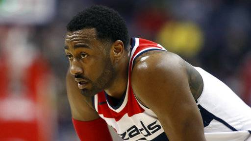 FILE - In this Jan. 10, 2018, file photo, Washington Wizards guard John Wall (2) pauses on the court during the second half of an NBA basketball game against the Utah Jazz in Washington. Wall will have arthroscopic surgery on his left knee on Wednesday and could miss much of the rest of the regular season, the Wizards announced Tuesday, Jan. 30, 2018.