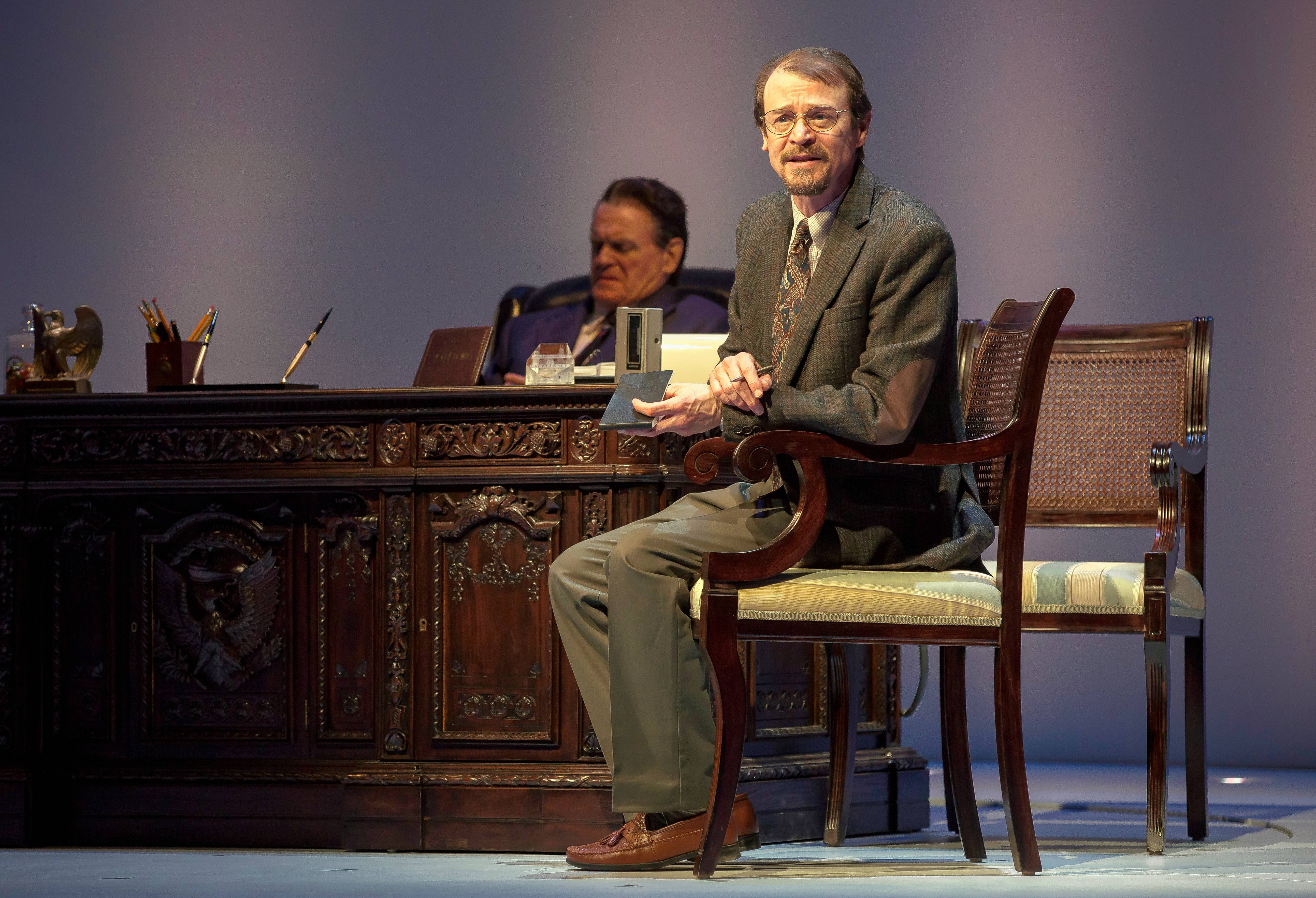 "Biographer Edmund Morris (Thomas J. Cox), right, tries to sort through inconsistencies in anecdotes shared by President Ronald Reagan (Rob Riley) in Goodman Theatre's ""Blind Date."""