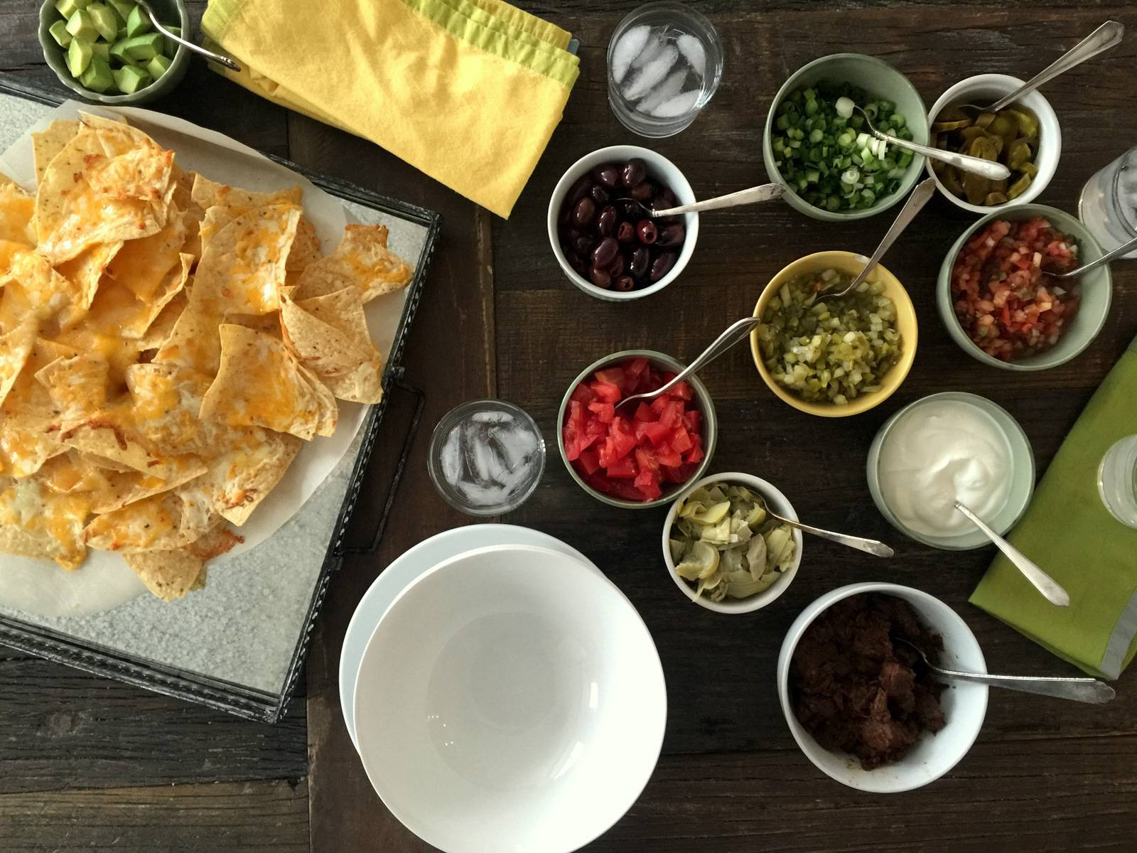 A nacho bar is ready for action for your guests to pick and choose topping at will.