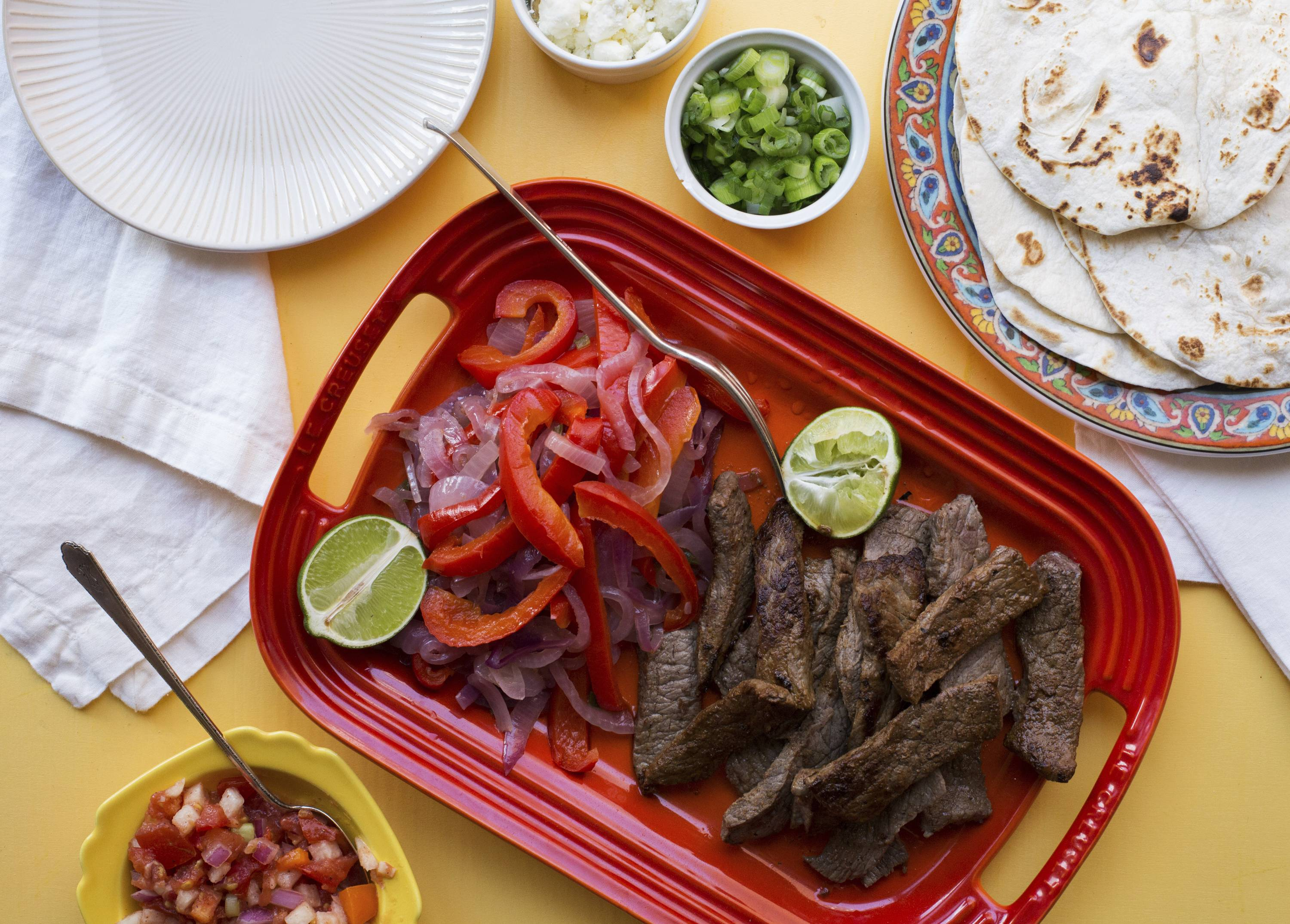Let your guests put together their own steak fajitas on game day.