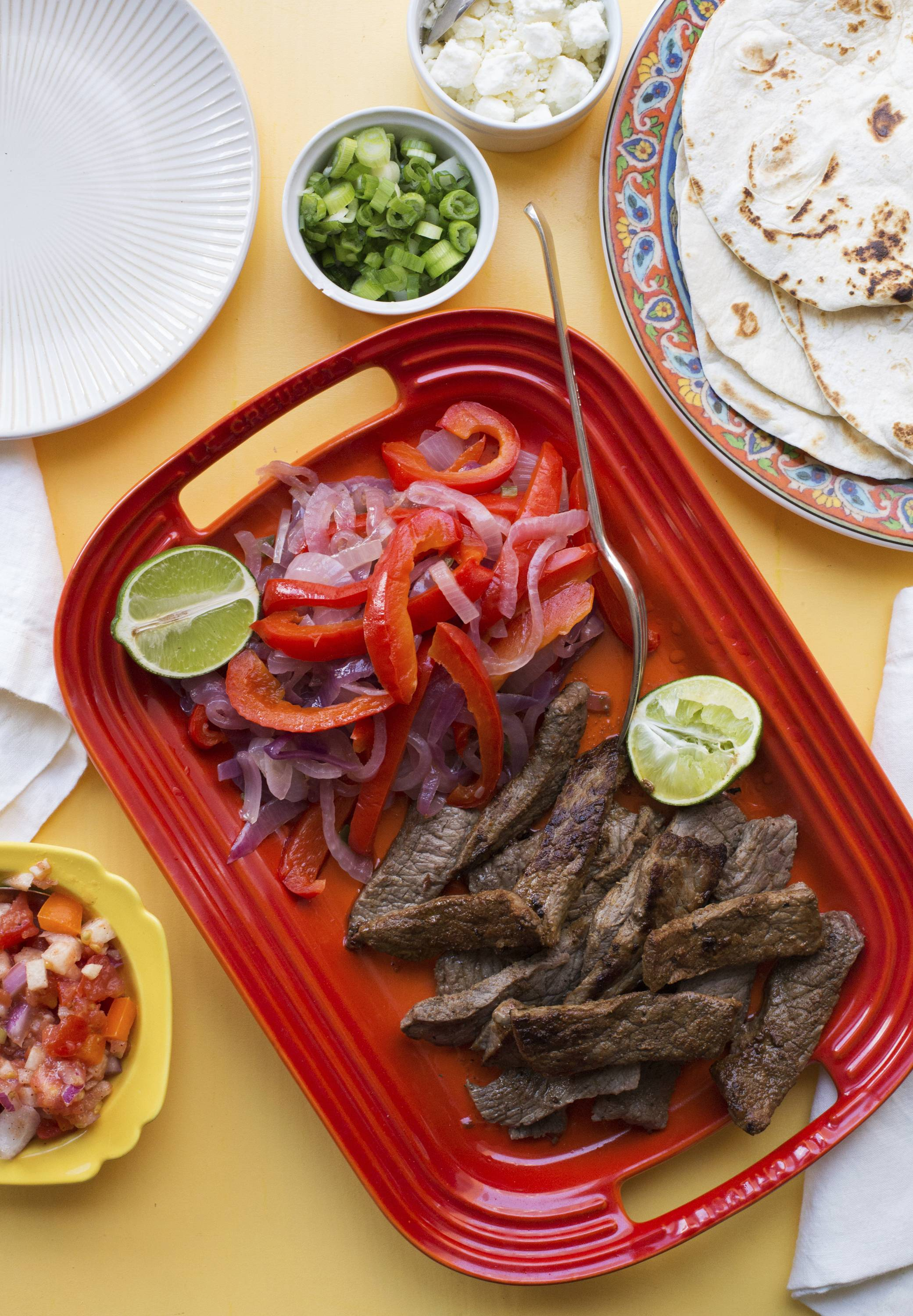 Wonderfully customizable, steak fajitas perfect for a game day spread. Let your guests put them together to taste.