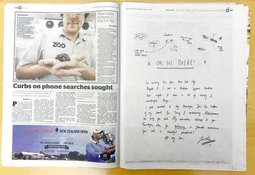 New Zealand singer songwriter Lorde's handwritten thank - you note, right, is published in a the New Zealand Herald newspaper, Wednesday, Jan. 31, 2018, honoring fellow Kiwi musicians as well as sightings of other attendees at the Grammy ceremony in New York. Lorde has scribbled her thanks to fans back home for embracing her Grammy-nominated album.