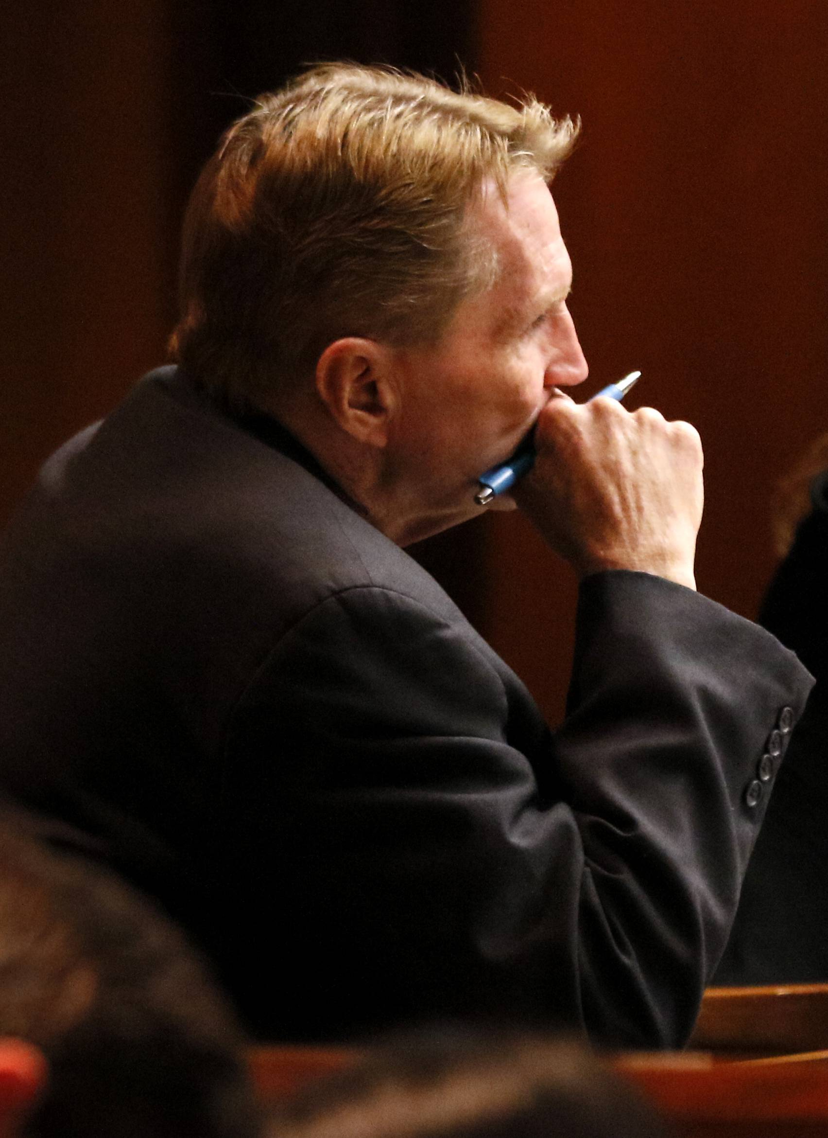 William Amor listens to opening statements at the DuPage County Courthouse in Wheaton on Wednesday, January 24, 2018. Amor is on trial for charges of first-degree murder and arson in the 1995 death of his mother-in-law in Naperville.
