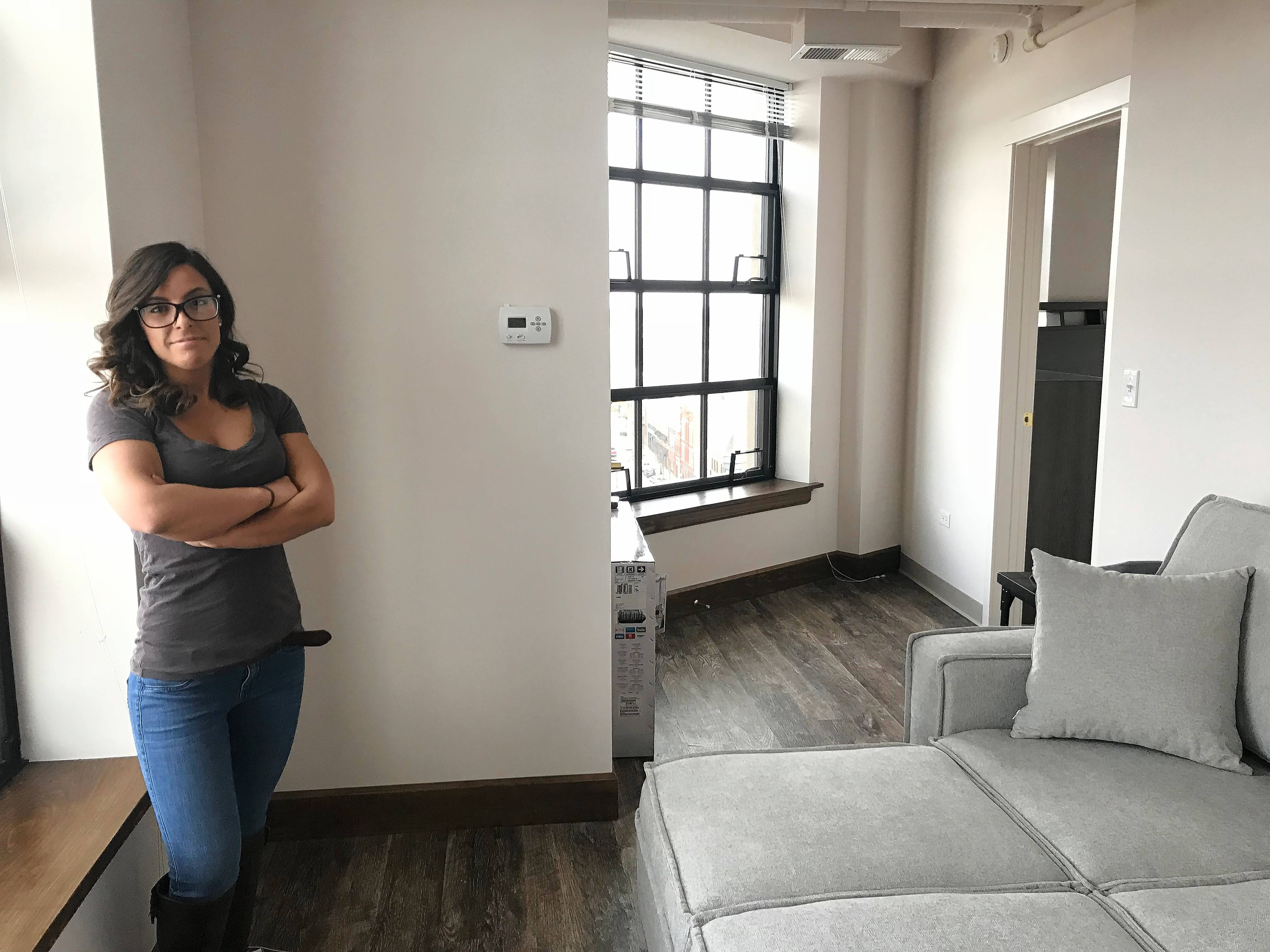 Nicole Dosek of Shorewood said she fell in love with the Elgin Tower Building when she visited it earlier this month. She was the first tenant to move in last Friday.