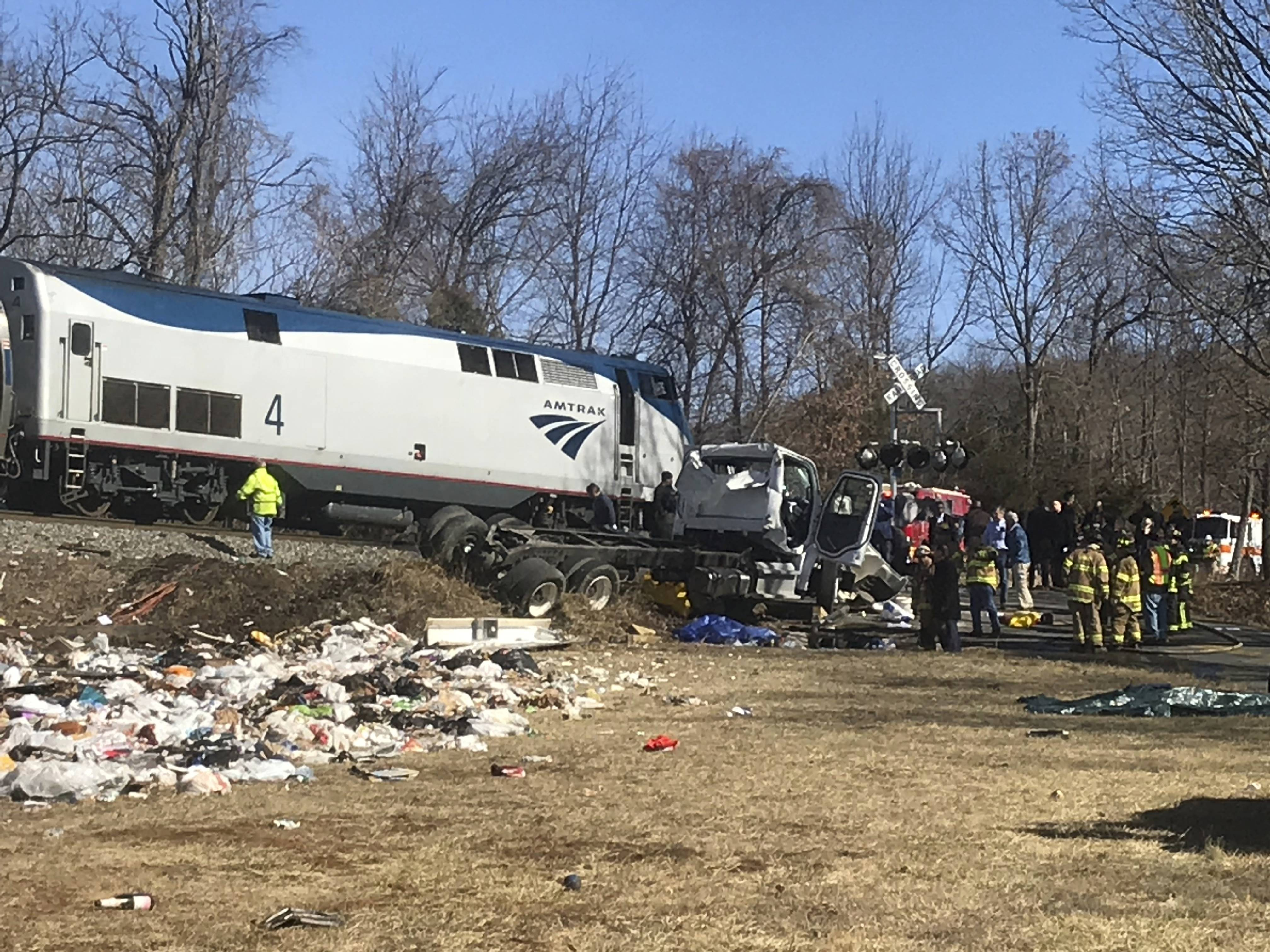 Emergency personnel work at the scene of a train crash involving a garbage truck in Crozet, Va., on Wednesday, Jan. 31, 2018. An Amtrak passenger train carrying dozens of GOP lawmakers to a Republican retreat in West Virginia struck a garbage truck south of Charlottesville, Va. No lawmakers were believed injured, but it at least one person in the truck was said to be seriously injured. (Allison Wrabel/ The Daily Progress via AP)