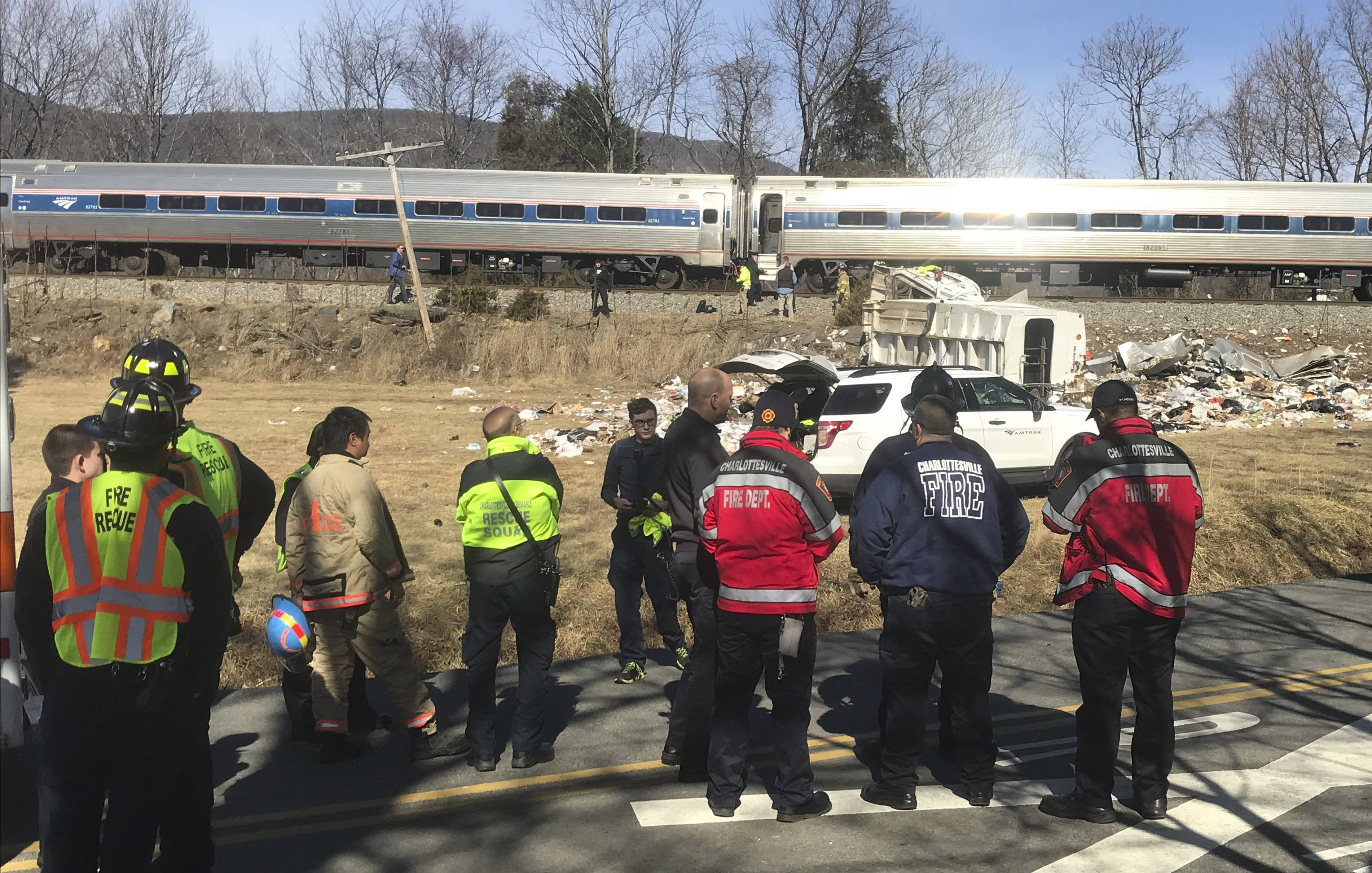 Emergency personnel standby near a chartered train carrying members of Congress after it hit a garbage truck in Crozet, Va., Wednesday, Jan. 31, 2018. No lawmakers were believed injured.   (Zack Wajsgrasu/The Daily Progress via AP)