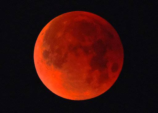 A super blue blood moon is seen over Los Angeles on Wednesday Jan. 31, 2018. The moon is putting on a rare cosmic show. It's the first time in 35 years a blue moon has synced up with a supermoon and a total lunar eclipse. NASA is calling it a lunar trifecta: the first super blue blood moon since 1982. That combination won't happen again until 2037.