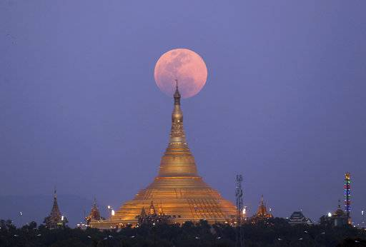 The moon rises behind the Uppatasanti Pagoda seen from Naypyitaw, Myanmar, Wednesday, Jan. 31, 2018.