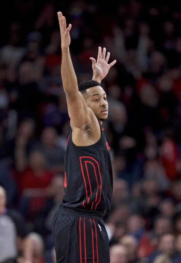 Portland Trail Blazers guard CJ McCollum reacts after making a three-point basket during the first half of an NBA basketball game against the Chicago Bulls in Portland, Ore., Wednesday, Jan. 31, 2018.