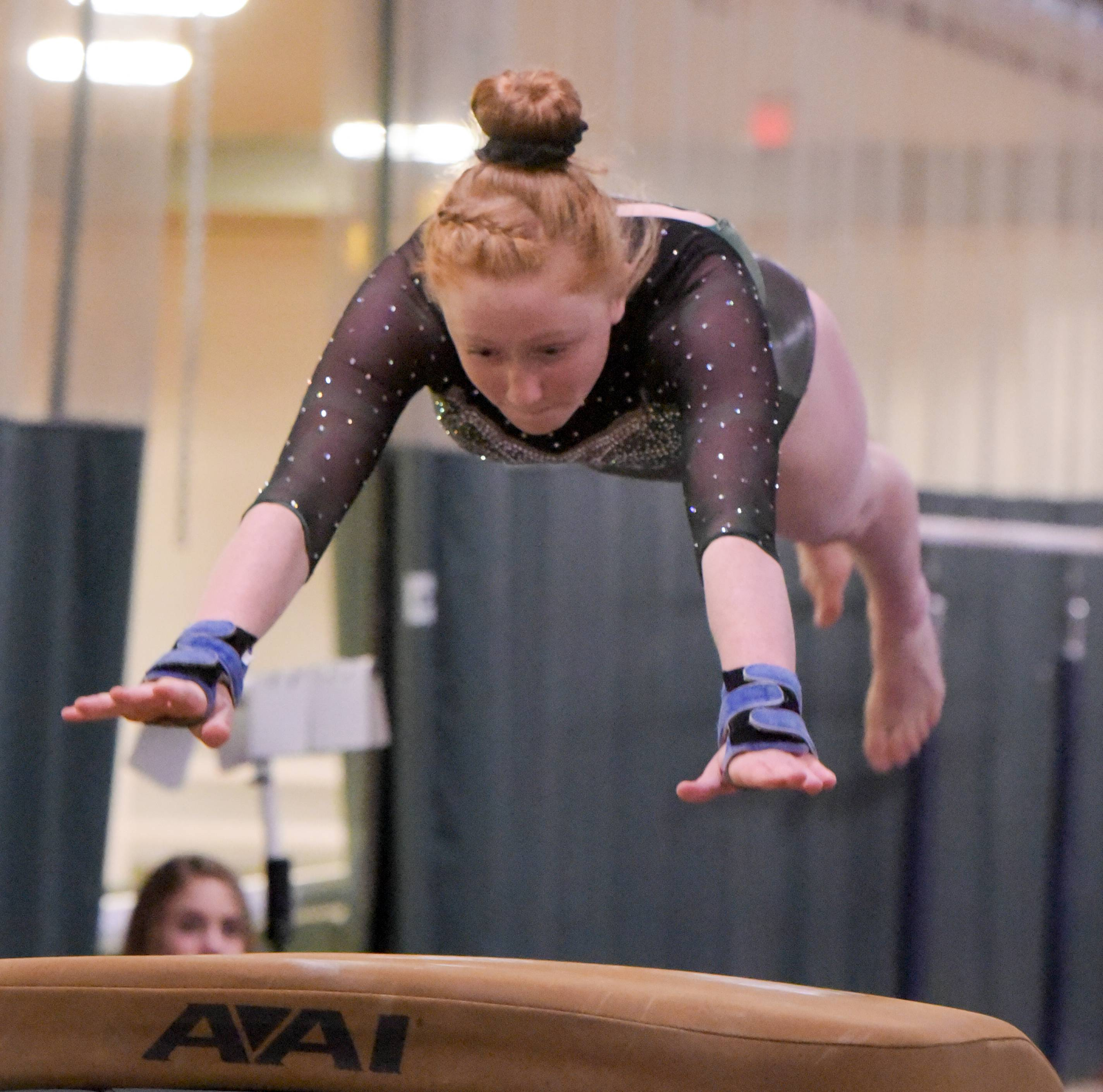 Glenbard West's Katherine Hoban competes on the vault during the Glenbard West regional gymnastics meet on Wednesday, Jan. 31, 2018.