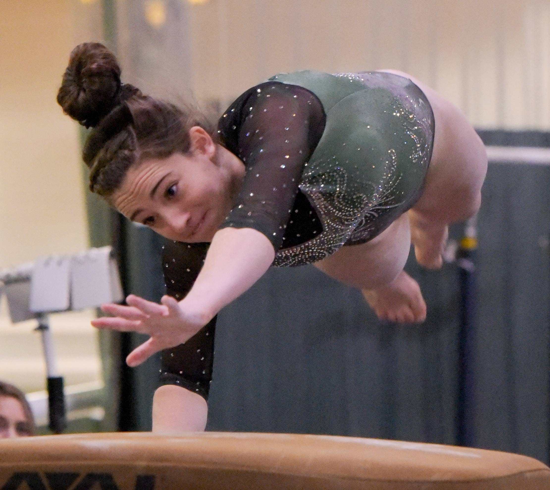 Glenbard West's Maddie Diab competes on the vault during the Glenbard West regional gymnastics meet on Wednesday, Jan. 31, 2018.