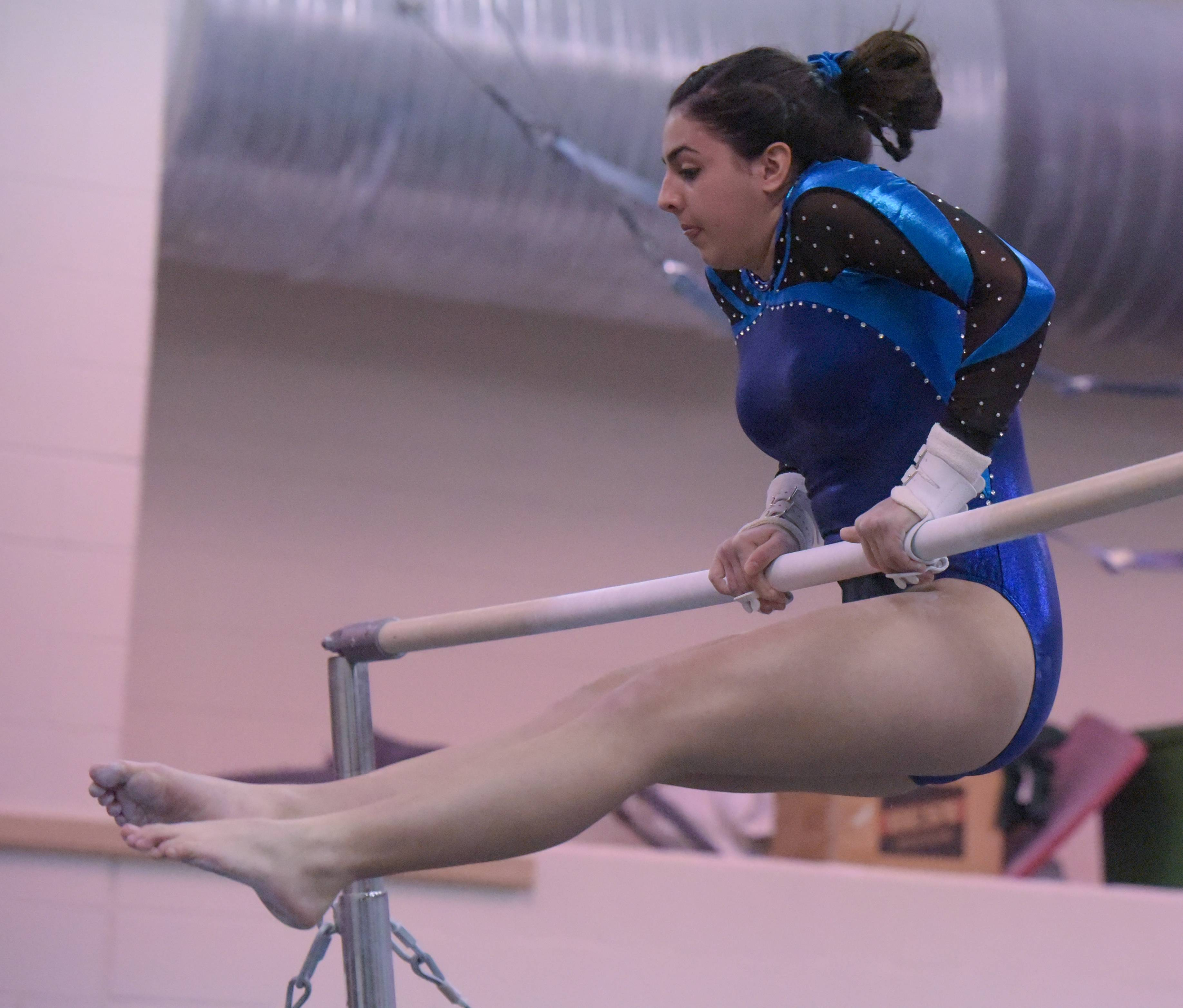 Addison Trial's Lauren Stamatopoulos competes on the bars during the Glenbard West regional gymnastics meet on Wednesday, Jan. 31, 2018.