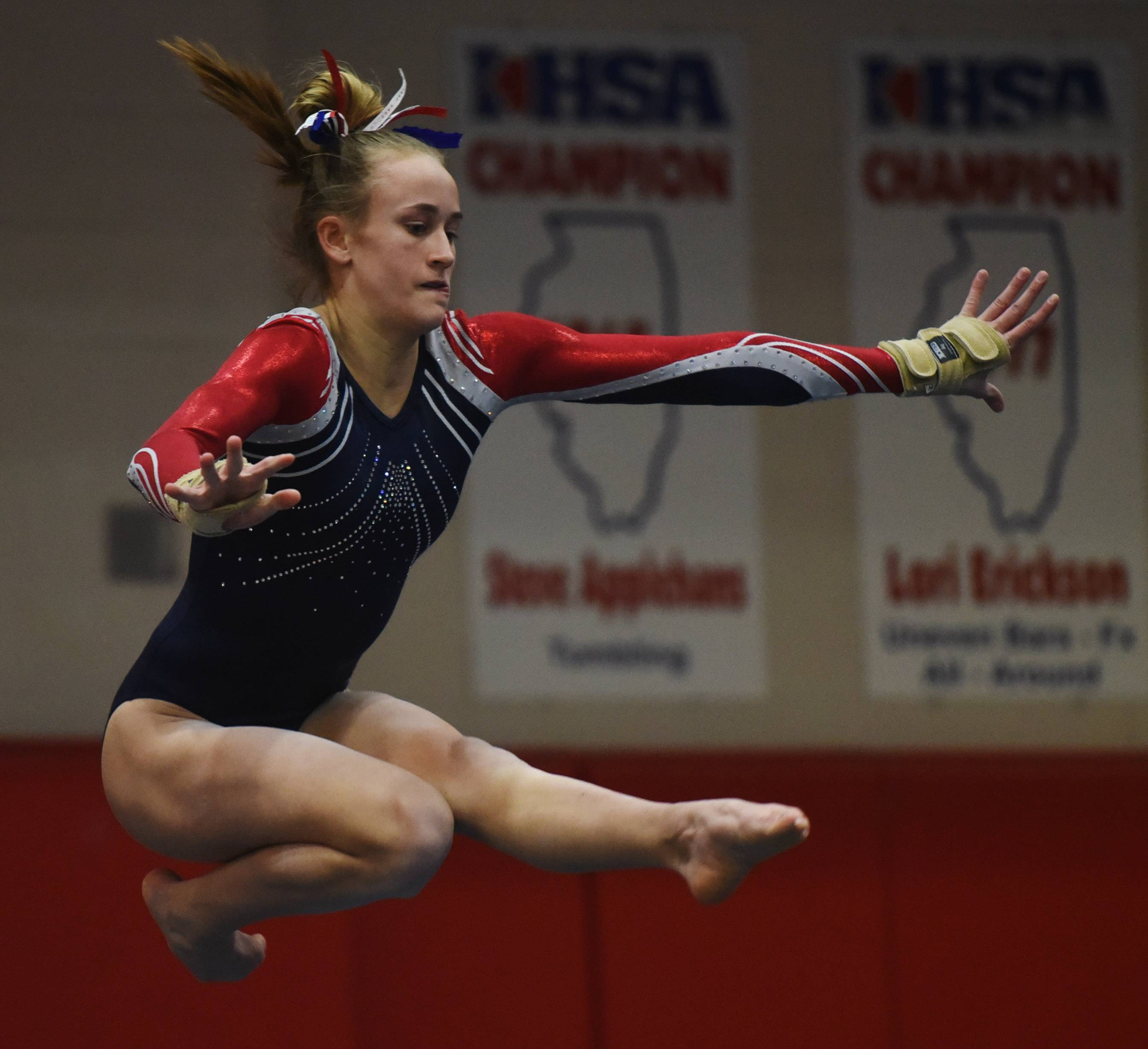 Conant's Danielle Smith competes on the floor exercise during the Palatine regional Wednesday.