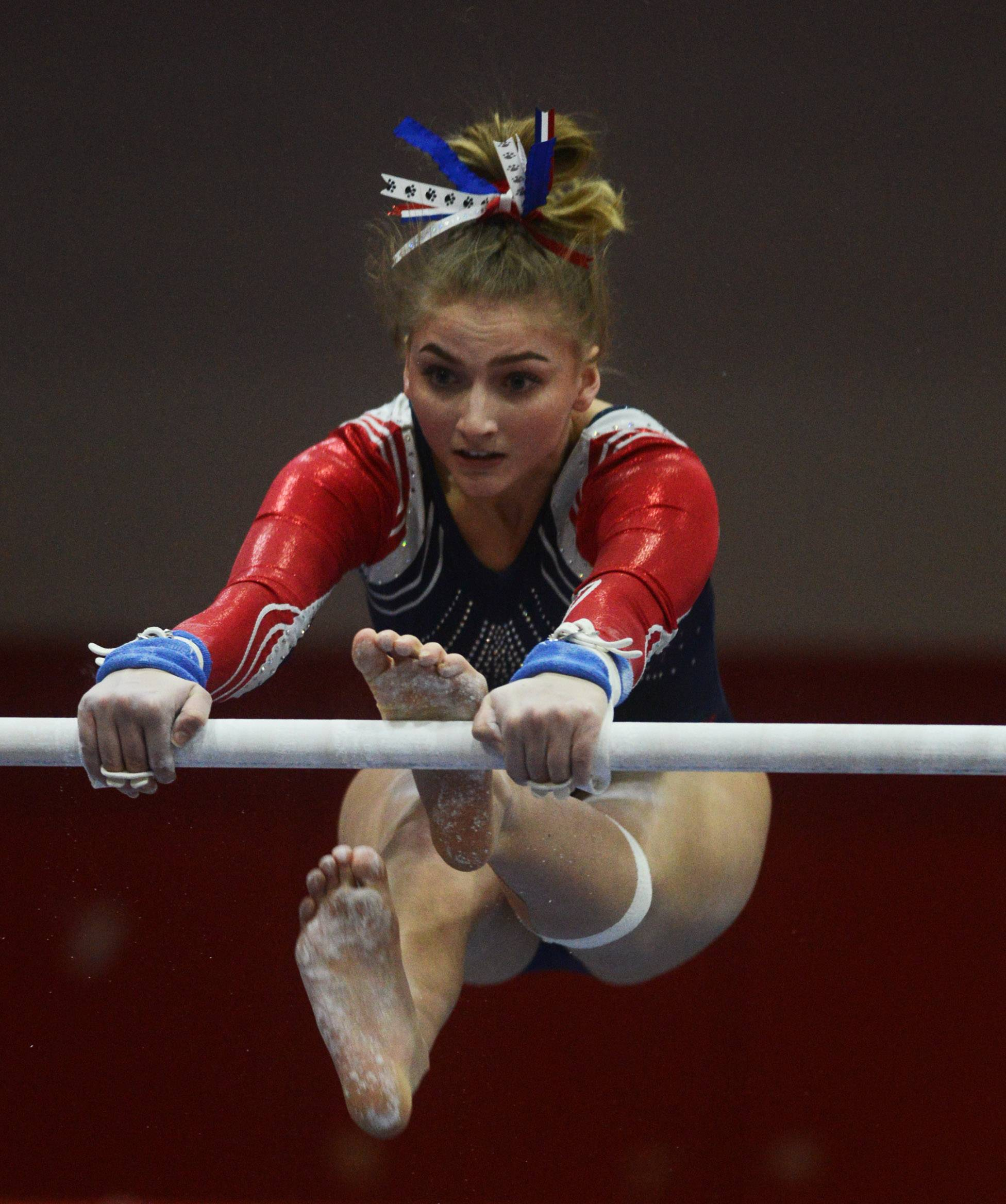 Conant's Bailey Bloom competes on the uneven parallel bars during the Palatine regional Wednesday.