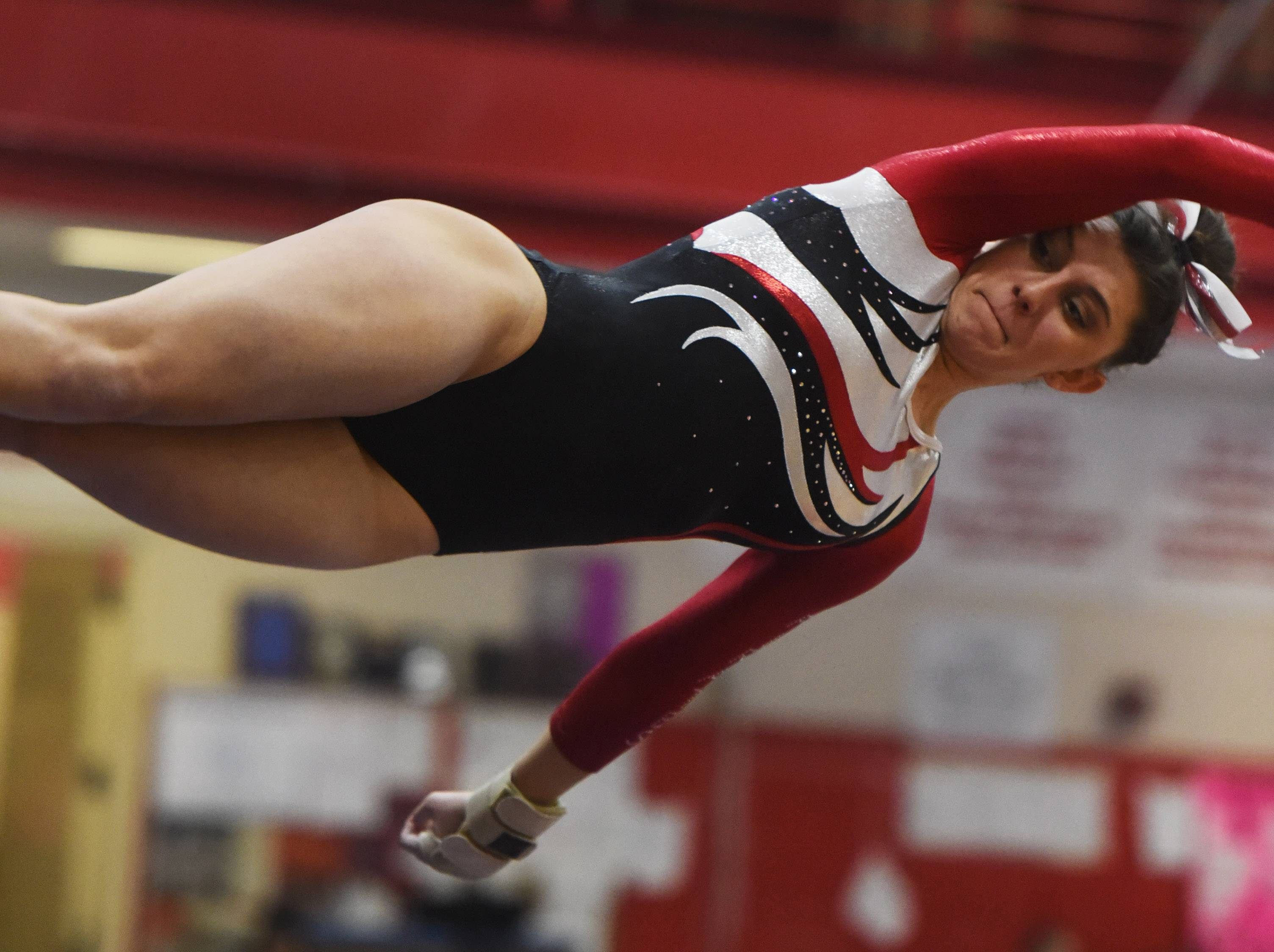 Palatine's Abby Amato competes on vault during the Palatine regional Wednesday.